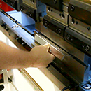 the bracket being formed by the press brake