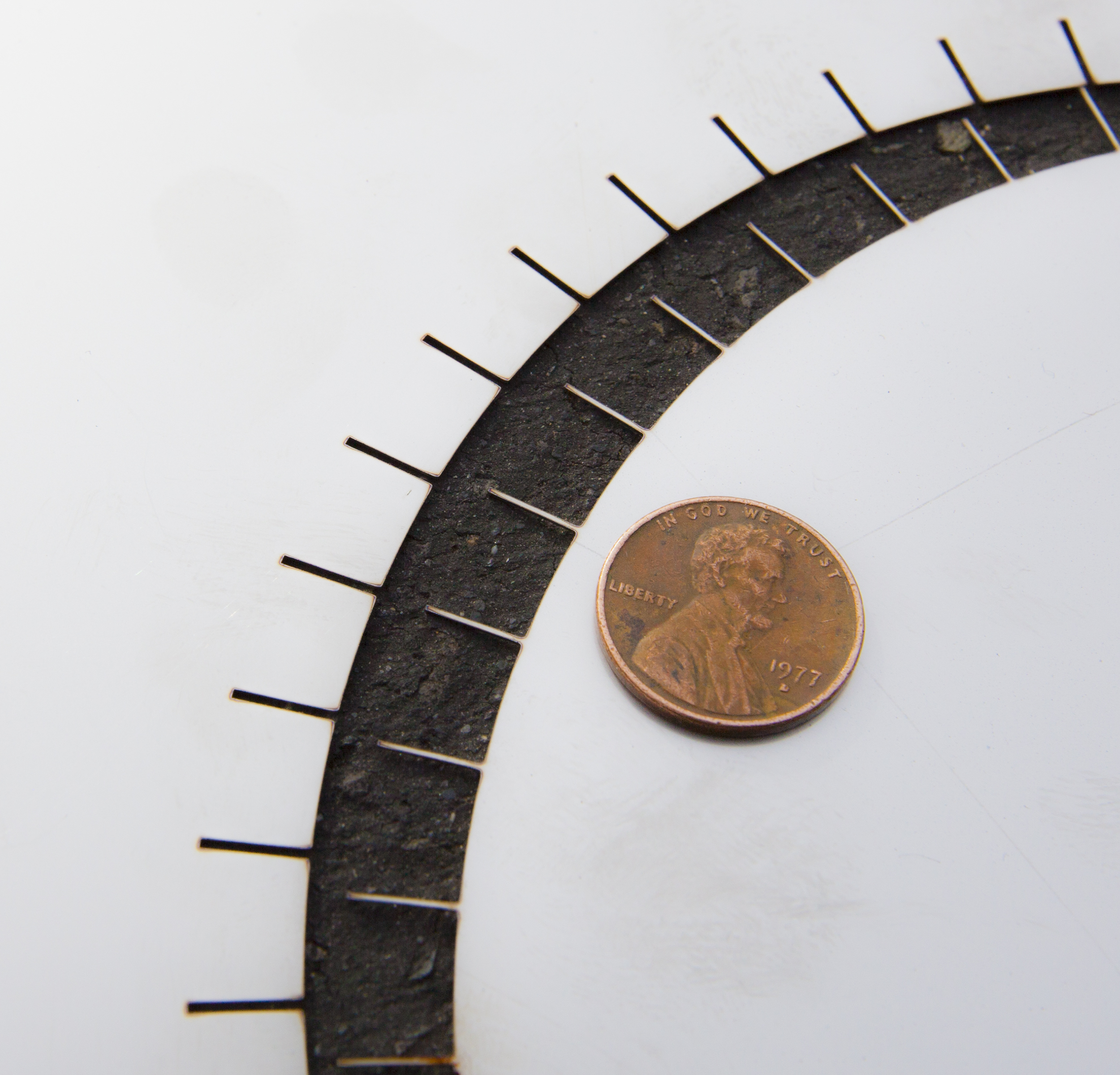 A penny next to a cut to show the precision detail