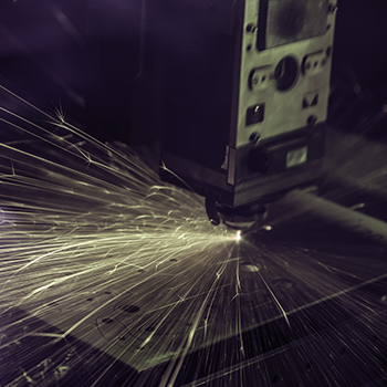 Laser hitting metal causing sparks